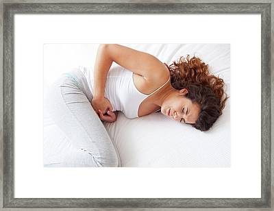Woman With Cramps Framed Print by Ian Hooton