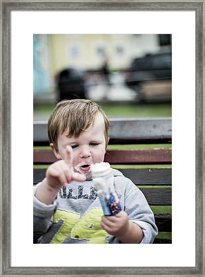 Young Boy Eating An Ice Cream Framed Print by Samuel Ashfield