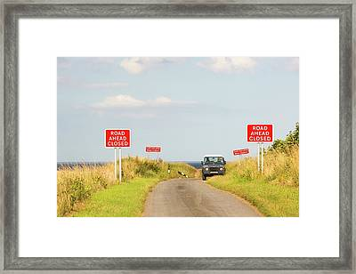 A Collapsed Coastal Road Near Aldbrough Framed Print by Ashley Cooper