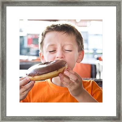 Boy With Donut Framed Print by Tom Gowanlock