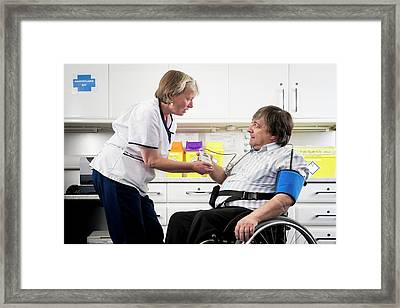 Check Up With Disabled Man Framed Print by Jim Varney