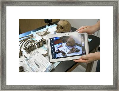 Forensic Scientist Identifying Remains Framed Print by Jim West