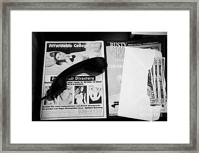 us dollars cash left in an envelope by the side of the bed in a hotel room in Las Vegas Nevada USA Framed Print by Joe Fox