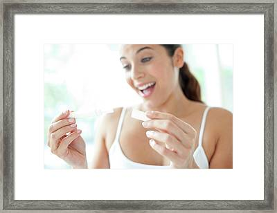 Woman Taking Pregnancy Test Framed Print by Ian Hooton