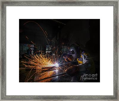 Worker Welding  Framed Print by Anek Suwannaphoom