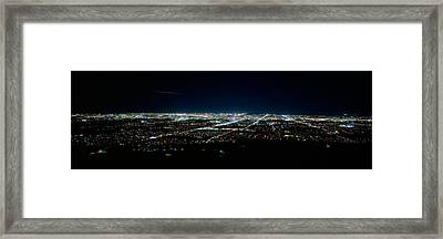 Aerial View Of A City Lit Up At Night Framed Print by Panoramic Images
