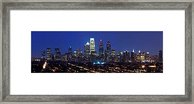 Buildings Lit Up At Night In A City Framed Print by Panoramic Images