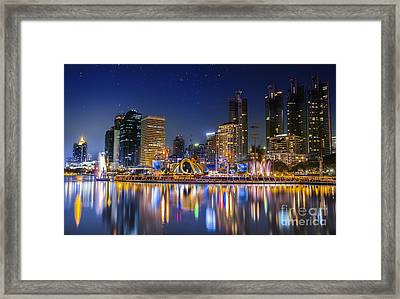 City Town At Night Framed Print by Anek Suwannaphoom
