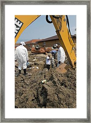 Repairing Hurricane Katrina Damage Framed Print by Jim West