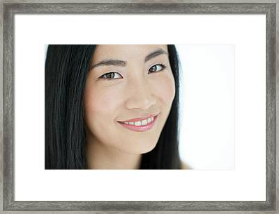 Woman Smiling Framed Print by Ian Hooton