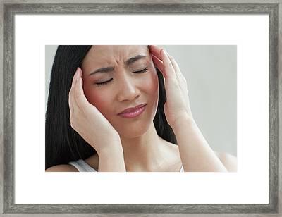 Woman Touching Head Framed Print by Ian Hooton