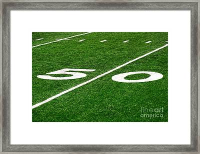50 Yard Line On Football Field Framed Print by Paul Velgos
