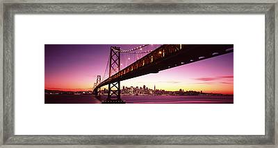Bridge Across A Bay With City Skyline Framed Print by Panoramic Images