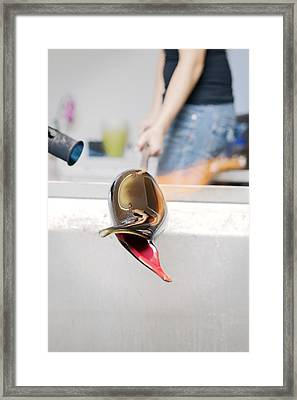 Glassblower At Work Framed Print by Thomas Fredberg