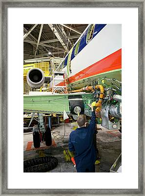 Aircraft Maintenance Framed Print by Jim West