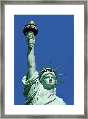 Statue Of Liberty In New York Harbor Framed Print by Brian Jannsen