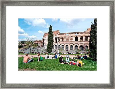Outside Colosseum In Rome Framed Print by George Atsametakis