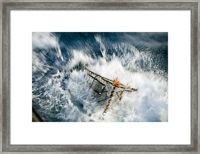 A Baited Pot Crashes Into The Water Framed Print by Scott Dickerson