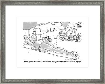 A Bald Man Sunning Himself On The Beach Tries Framed Print by Michael Crawford