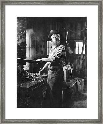A Blacksmith At His Forge Framed Print by Underwood Archives