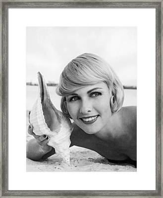 A Blonde And A Shell Framed Print by Underwood Archives