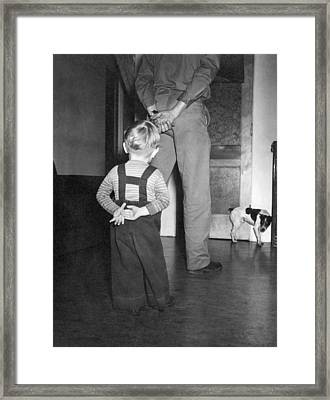 A Boy Imitates His Father Framed Print by Underwood Archives