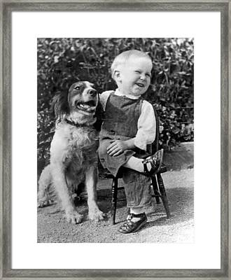 A Boy Laughs With His Dog Framed Print by Underwood Archives