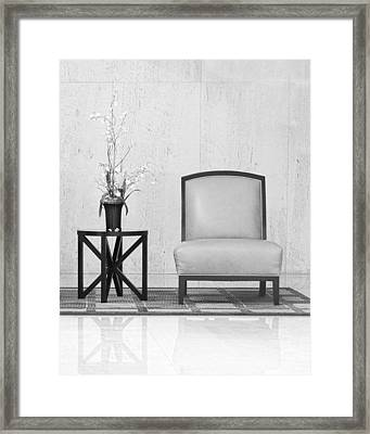 A Chair And A Table With A Plant  Framed Print by Rudy Umans