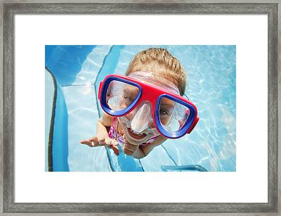 A Child With Goggles Framed Print by Don Hammond
