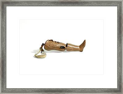 A Child's Prosthetic Leg Framed Print by Gregory Davies