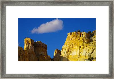 A Cloud Over Orange Rock Framed Print by Jeff Swan