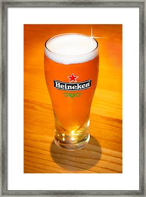 A Cold Refreshing Pint Of Heineken Lager Framed Print by Semmick Photo