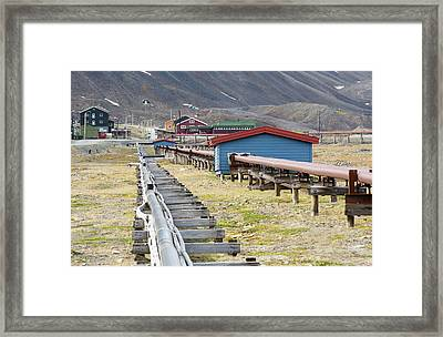 A Communal Heating System Framed Print by Ashley Cooper
