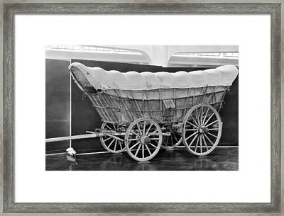 A Conestoga Covered Wagon Framed Print by Underwood Archives