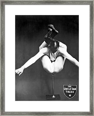 A Contortionist On A Pedestal Framed Print by Underwood Archives