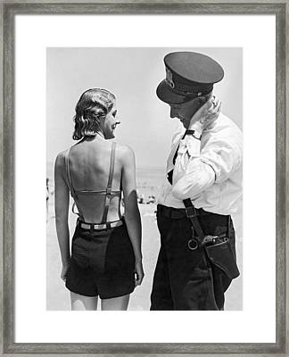 A Cop Polices Bathing Suits Framed Print by Underwood Archives