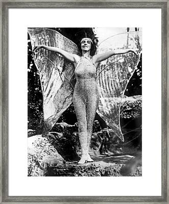 A Coral Gables Butterfly Woman Framed Print by Underwood Archives