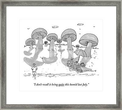 A Couple Lies On A Beach Which Is Sprouting Framed Print by Michael Crawford