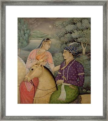 A Couple On Horseback Beside A Moonlit Framed Print by Mark Briscoe