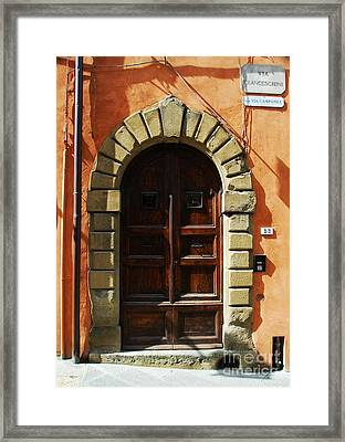 A Door In Tuscany Framed Print by Mel Steinhauer