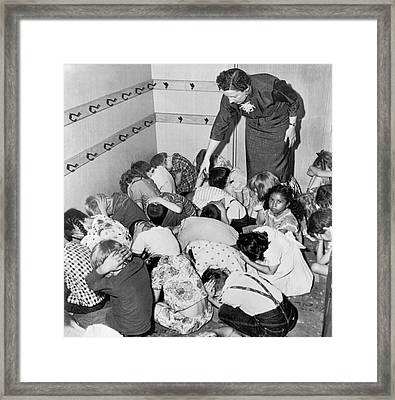 A Duck And Cover Exercise In A Kindergarten Class In 1954 Framed Print by Underwood Archives