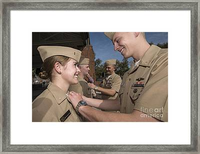 A Female Officer Recieves The Submarine Framed Print by Stocktrek Images