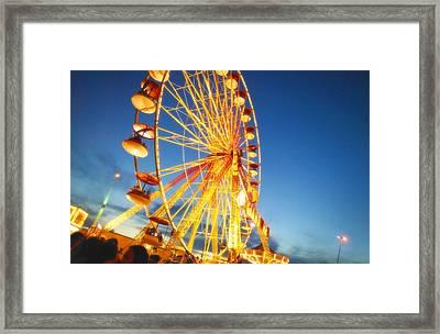 A Ferris Wheel At Night Framed Print by Don Hammond