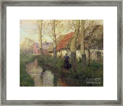 A French River Landscape With A Woman By Cottages Framed Print by Fritz Thaulow
