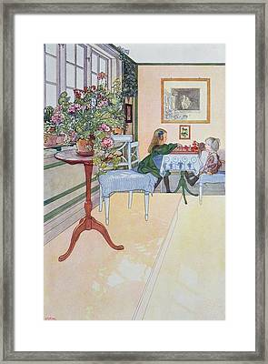 A Game Of Chess Framed Print by Carl Larsson
