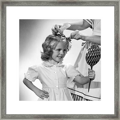 A Girl Gets A Bow Framed Print by Underwood Archives