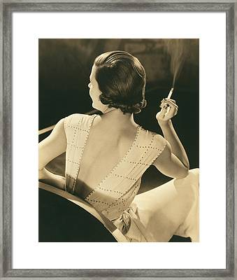 A Glamourous Woman Smoking Framed Print by Underwood Archives