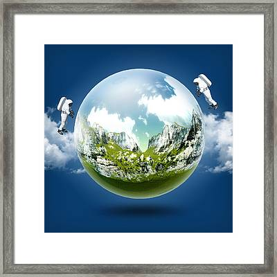 A Glass Transparent Ball Mountains Inside It With Astronaut On Blue Sky Framed Print by Thanes