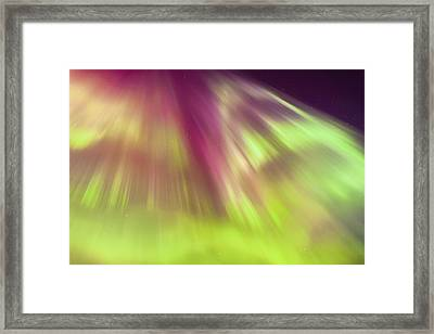A Green And Purple Northern Lights Framed Print by Kevin Smith