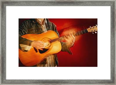A Guitar Player Framed Print by Don Hammond
